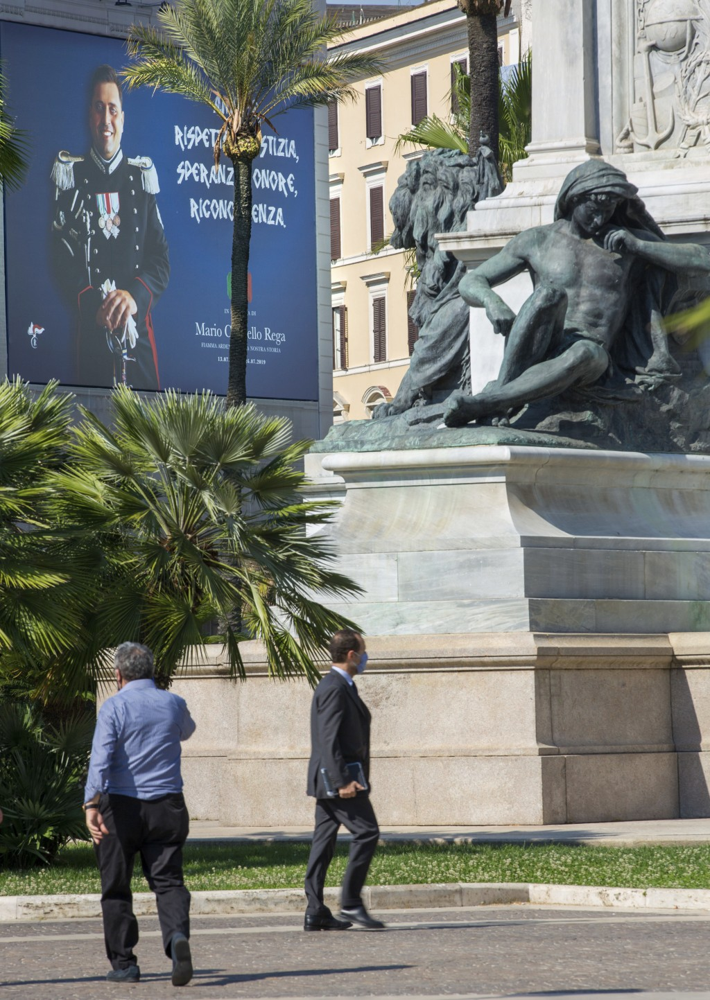 One of two posters portraying the Italian Carabinieri paramilitary police officer Mario Cerciello Rega is seen in the square where he was stabbed to d...