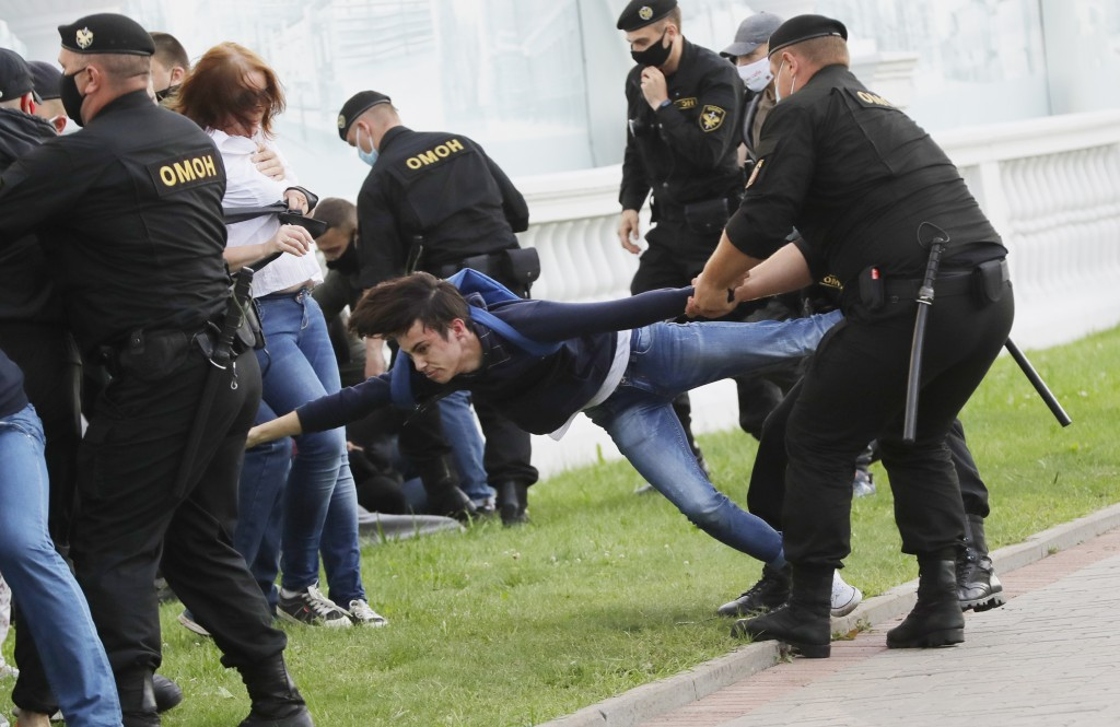 Police officers detain protesters during a protest rally against the removal of opposition candidates from the presidential elections in Minsk, Belaru...
