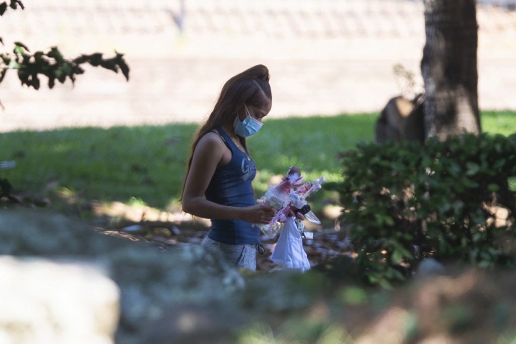 Charmaine Turner walks to a viewing her for 8-year-old daughter Secoriea Turner, who was fatally shot in Atlanta on July 4th near the Wendy's site whe...