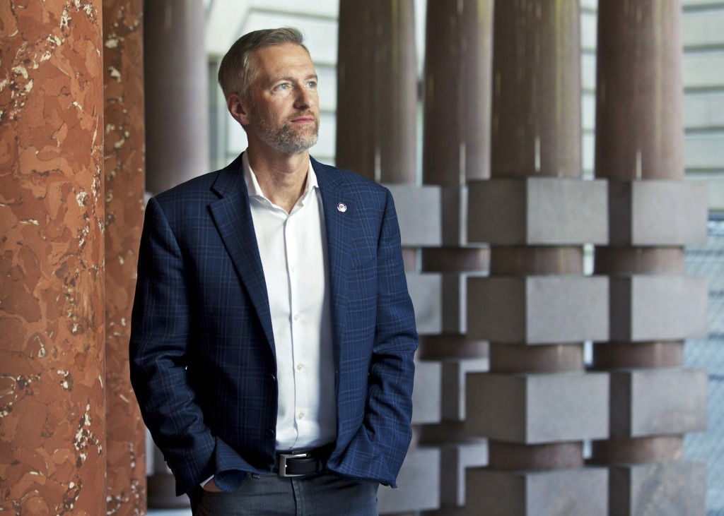 FILE - In this Aug. 5, 2019, file photo, Portland Mayor Ted Wheeler poses for a photo in Portland, Ore. As the city has been wracked by violent protes...