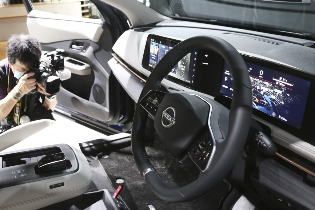 A photographer takes a photo of interior of Nissan Motor Co.'s new electric crossover Ariya at Nissan Pavilion in Yokohama near Tokyo Tuesday, July 14...