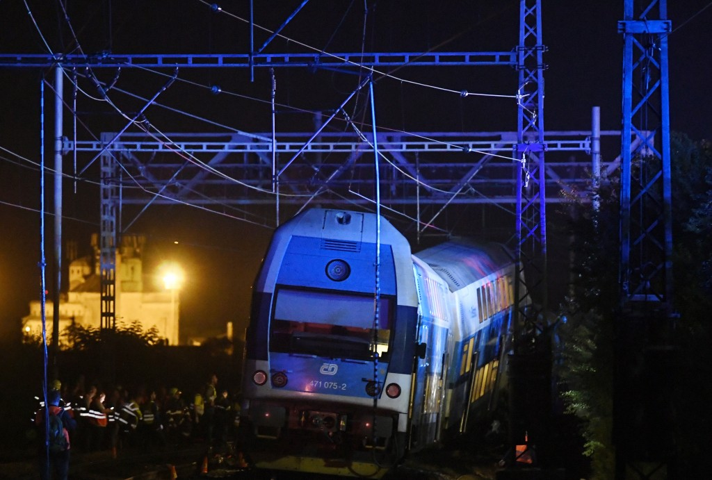 Rescuers work at the scene of a passenger and freight trains collision in Cesky Brod, Czech Republic, east of Prague, Tuesday, July 14, 2020. Dozens o...