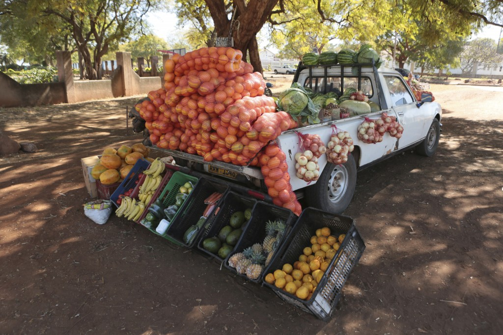A car displays fruits and vegetables while selling them by the side of a busy road in Harare, Zimbabwe, Saturday, July, 4, 2020. Cars have become mobi...