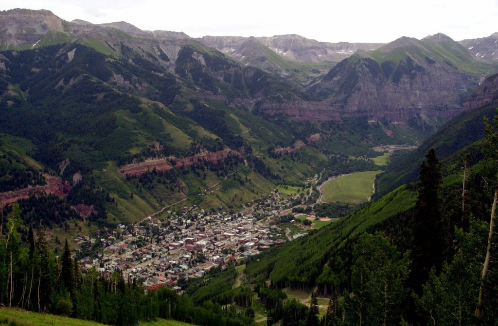 FILE - In this July 17, 2001, file photo, a view of Telluride, Colo. appears nestled in a valley from the top of Mount St. Sophia. The Telluride Film ...