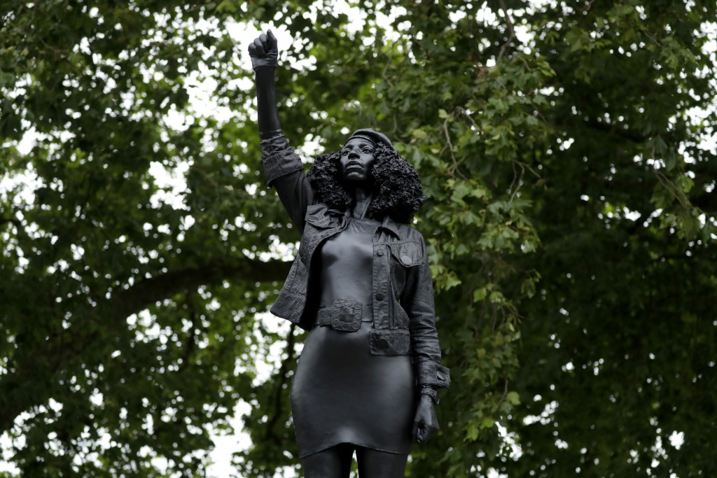 """A new black resin and steel statue entitled """"A Surge of Power (Jen Reid) 2020"""" by artist Marc Quinn stands after the statue was put up this morning on..."""