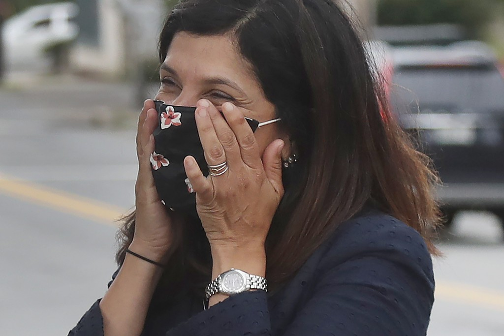 House Speaker Sara Gideon, D-Freeport, reacts as she speaks to people near a polling station, Tuesday, July 14, 2020, in Portland, Maine. Gideon is on...