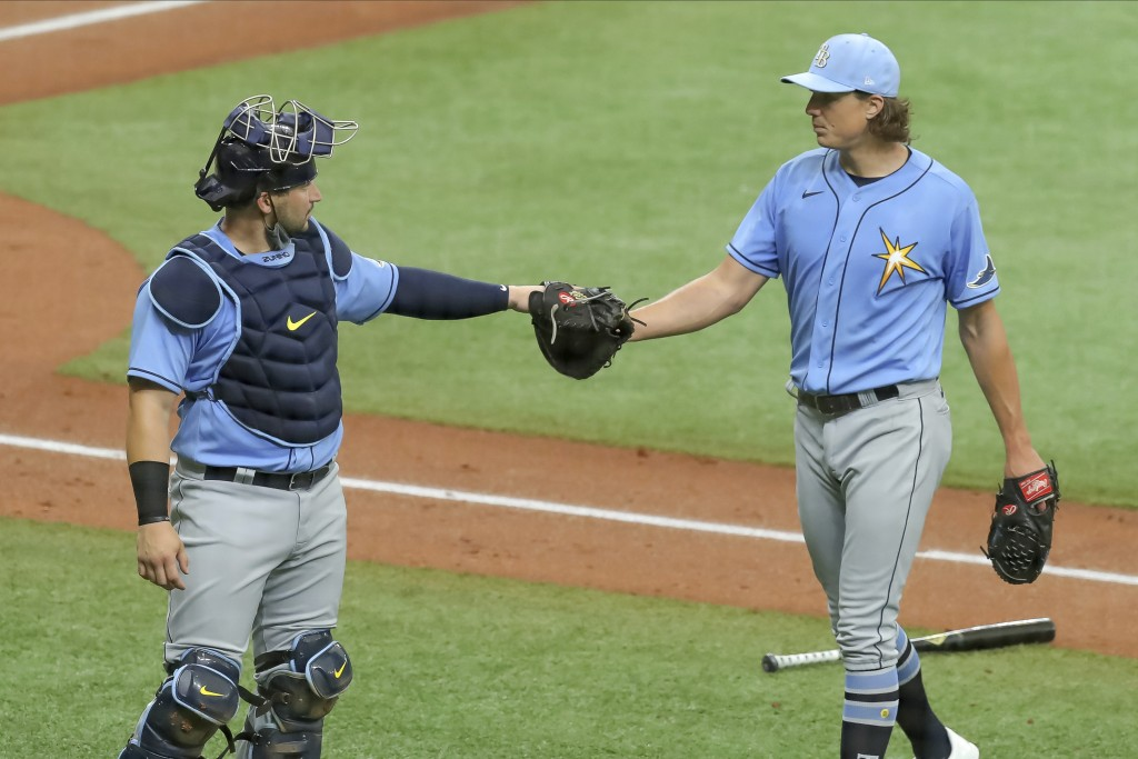 Tampa Bay Rays' Tyler Glasnow, right, bumps fists with catcher Mike Zunino after pitching during baseball practice Tuesday, July 14, 2020, in St. Pete...