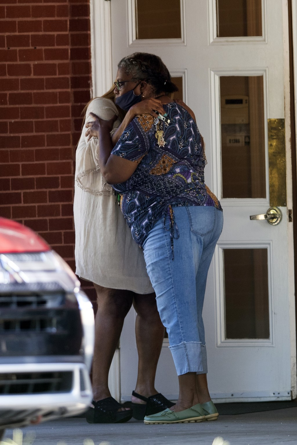 Two women embrace outside a viewing for 8-year-old Secoriea Turner, who was fatally shot in Atlanta on July 4th near the Wendy's site where Rayshard B...