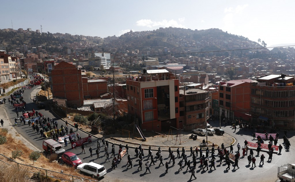 Demonstrators protest against the government's response to the COVID-19 pandemic in La Paz, Bolivia, Tuesday, July 14, 2020. The protest, convoked by ...