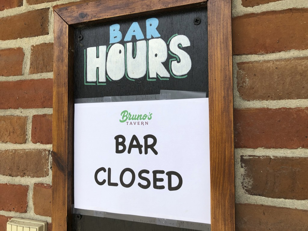 A sign hangs outside Bruno's Tavern in New Orleans on Tuesday, July 14, 2020. Bruno's is one of many bars around the city that shut down under new res...