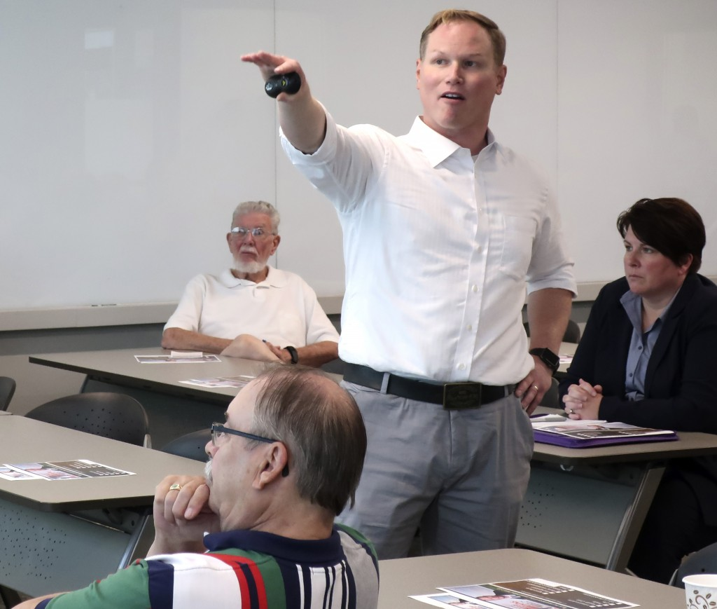 FILE - In this Aug. 26, 2019, file photo, U.S. Rep. Steve Watkins, R-Kan., makes a point during a town hall meeting, in Topeka, Kan. Watkins, a freshm...