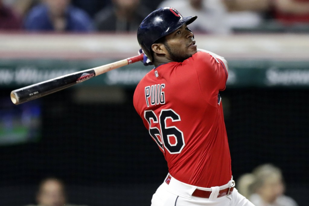 FILE - In this Sept. 18, 2019, file photo, Cleveland Indians' Yasiel Puig watches his ball after hitting the game-winning RBI-single in the 10th innin...