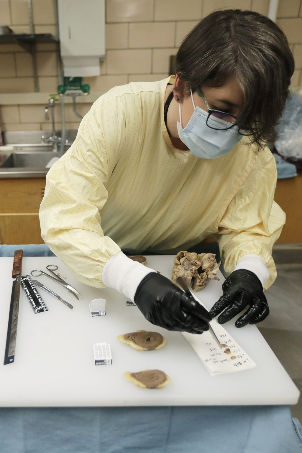 Dr. Desiree Marshall, director of Autopsy and After Death Services for University of Washington Medicine, prepares samples from the preserved heart of...