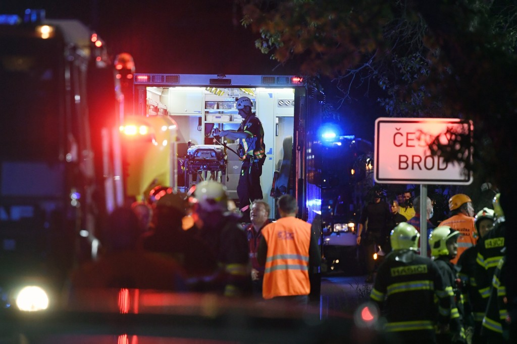 Rescuers help passengers at the scene of a passenger and freight train collision in Cesky Brod, Czech Republic, east of Prague, Tuesday, July 14, 2020...
