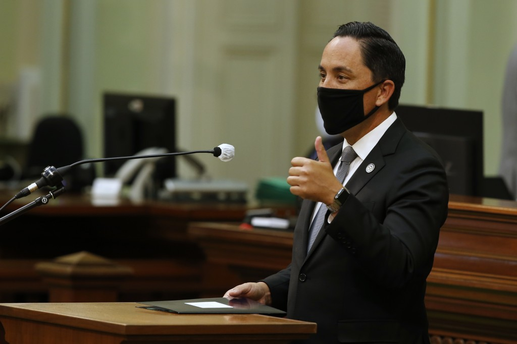 FILE - In this Monday, June 8, 2020, file photo, Assemblyman Todd Gloria, D-San Diego, gives a thumbs-up as he asks lawmakers to approve his measure t...