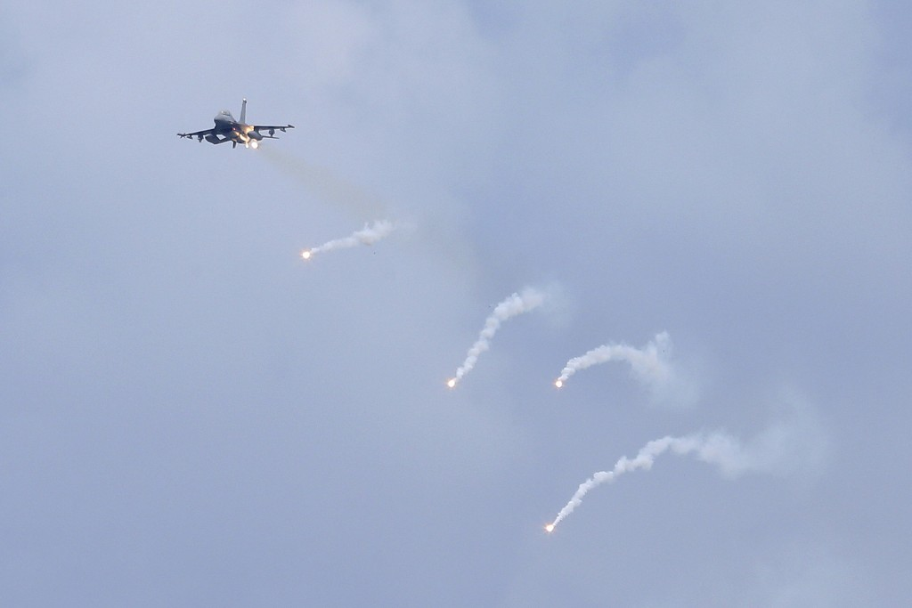 A U.S.-made F-16V fighter jet launches flares during the 36th Han Kung military exercises in Taichung City, central Taiwan, Thursday, July 16, 2020. T...