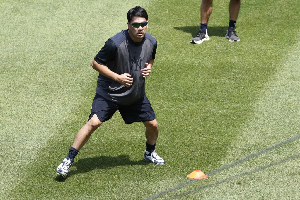 New York Yankees starting pitcher Masahiro Tanaka runs through drills at the Yankees summer baseball training camp, Wednesday, July 15, 2020, at Yanke...
