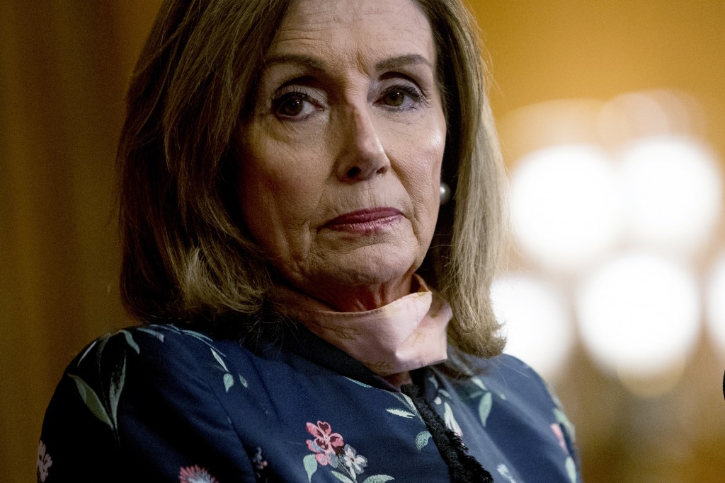 House Speaker Nancy Pelosi of Calif., pauses during a news conference on Capitol Hill in Washington, Wednesday, July 15, 2020, to mark two months sinc...