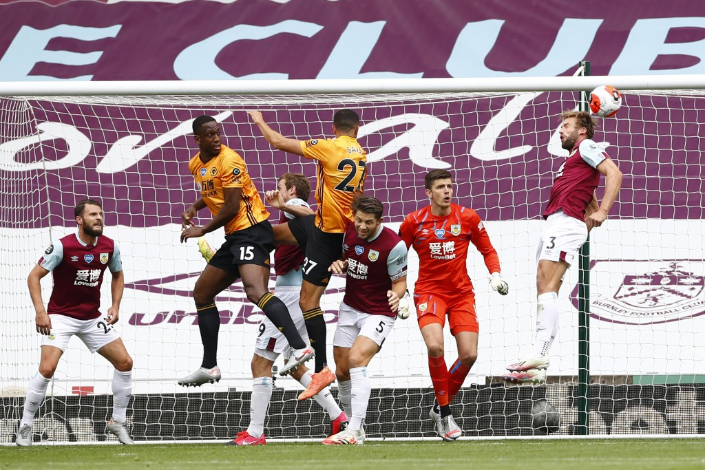 Wolverhampton Wanderers' Romain Saiss, centre, heads at goal during the English Premier League soccer match between Burnley and Wolverhampton Wanderer...