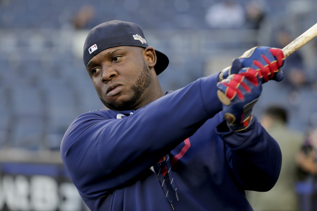 FILE - In this Oct. 4, 2019, file photo, Minnesota Twins third baseman Miguel Sano prepares to take batting practice before Game 1 of an American Leag...