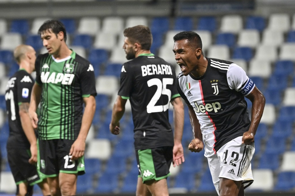 Juventus' Alex Sandro, right, celebrates after scoring a goal during a Serie A soccer match between Sassuolo and Juventus at the Mapei Stadium in Regg...