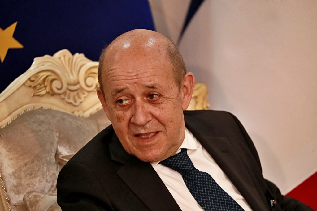 French Foreign Minister Jean-Yves Le Drian, meets with his meet his Iraqi counterpart Fouad Hussein in Baghdad, Iraq, Thursday, July 16, 2020. (AP Pho...