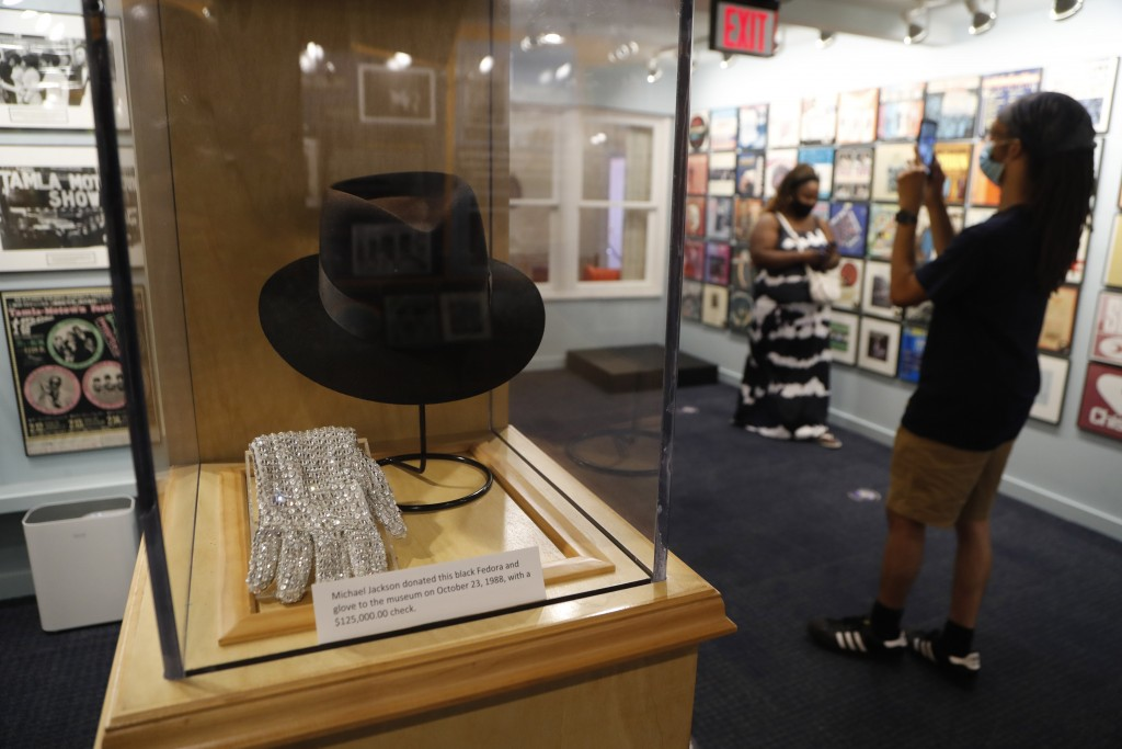 Michael Jackson's black Fedora and glove are displayed at the Motown Museum, Wednesday, July 15, 2020, in Detroit. The Detroit building where Berry Go...