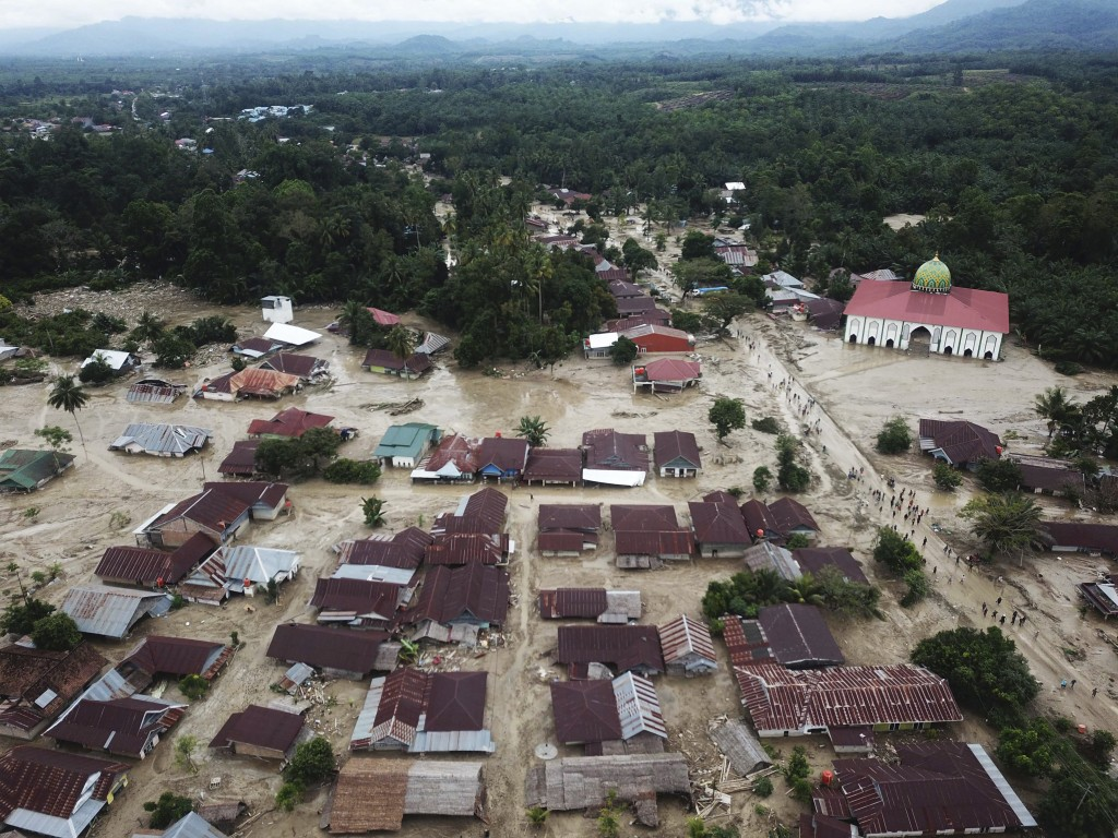 This aerial photo taken using a drone shows an area affected by flash floods in Luwu Utara, South Sulawesi province, Indonesia, Wednesday, July 15, 20...
