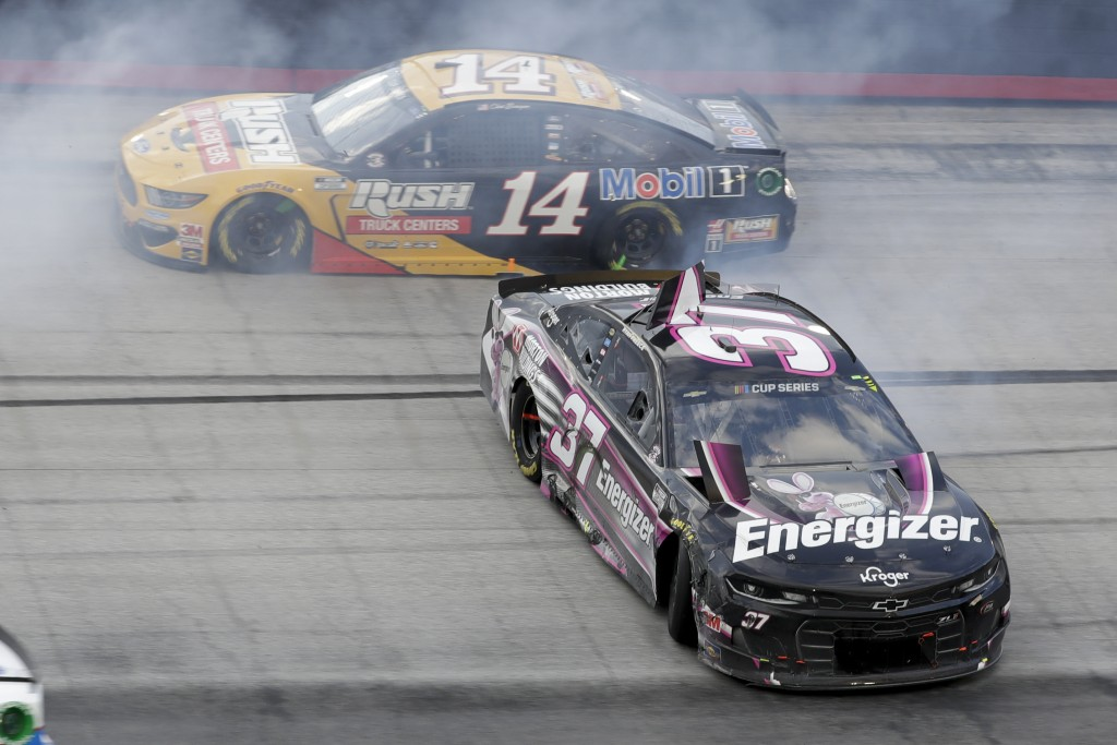 Ryan Preece (37) spins past Clint Bowyer (14) after a cash during a NASCAR All-Star Open auto race at Bristol Motor Speedway in Bristol, Tenn, Wednesd...