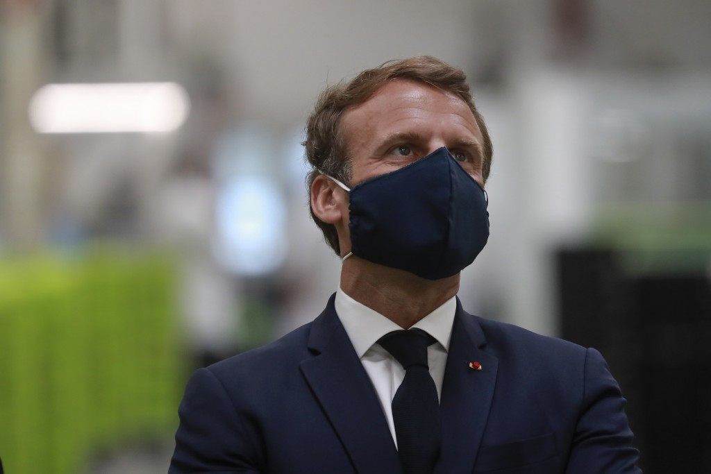 FILE - In this Tuesday, May 26, 2020 file photo, French President Emmanuel Macron wears a face mask as he visits the Valeo manufacturer plant, in Etap...