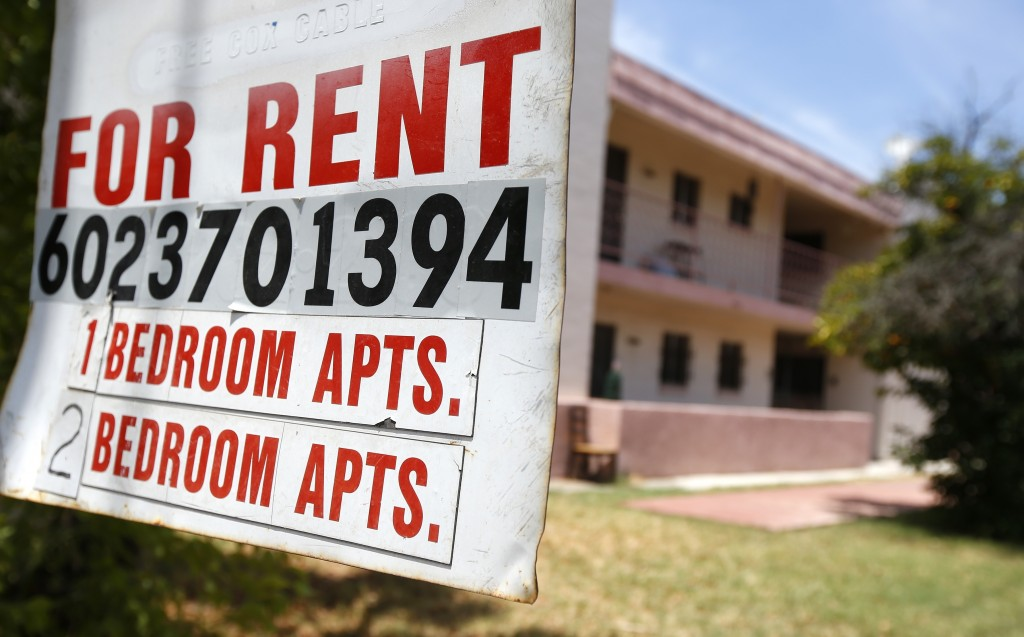 A rental sign is posted in front of an apartment complex Tuesday, July 14, 2020, in Phoenix. Housing advocacy groups have joined lawmakers lobbying Ar...