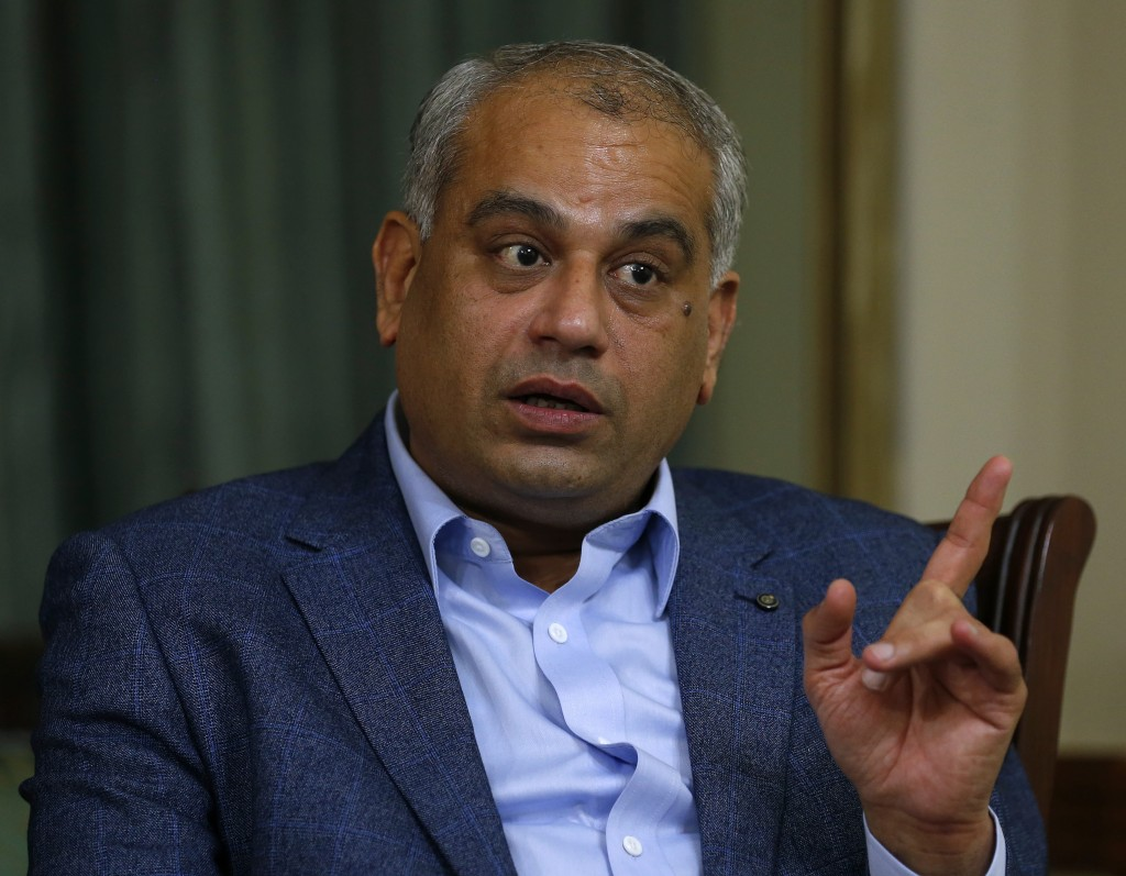 Lal Malhi, a Hindu minority Parliamentarian with Khan's Pakistan Insaf (Justice) party, speaks during an interview with The Associated Press, in Islam...
