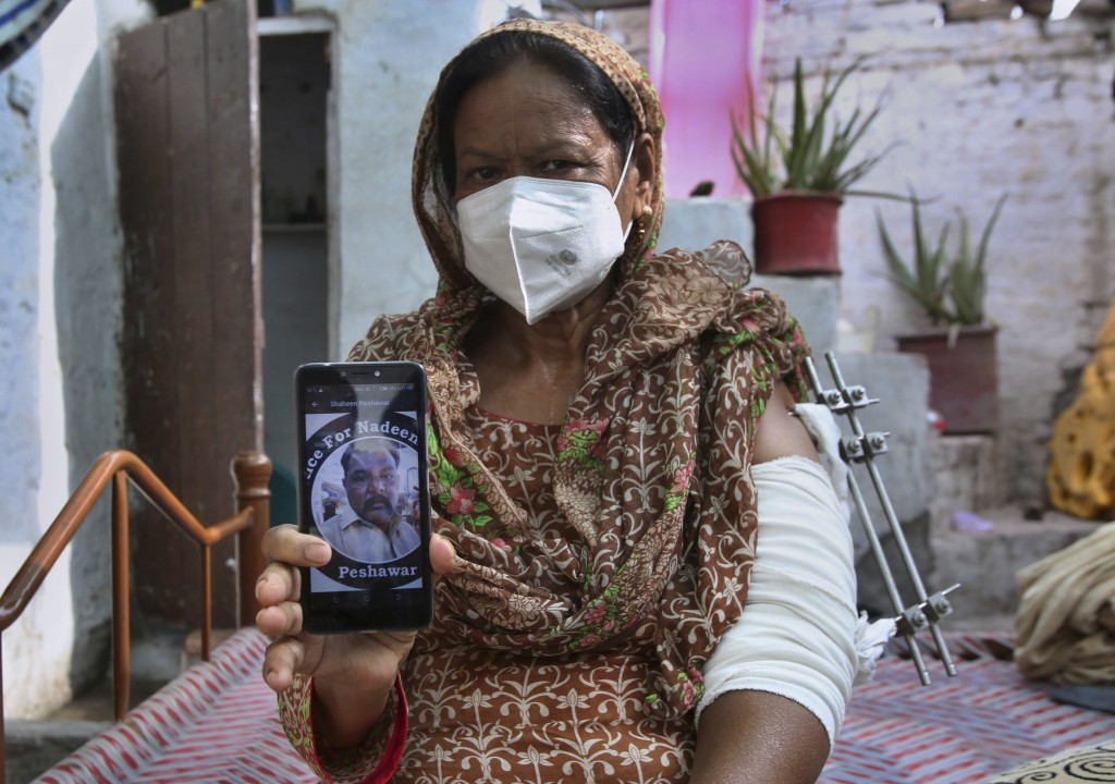 Elizabeth Lal, a Christian woman who was injured and her son-in-law Nadeem Jordon killed by gunmen because he rented in a Muslim neighborhood, shows a...