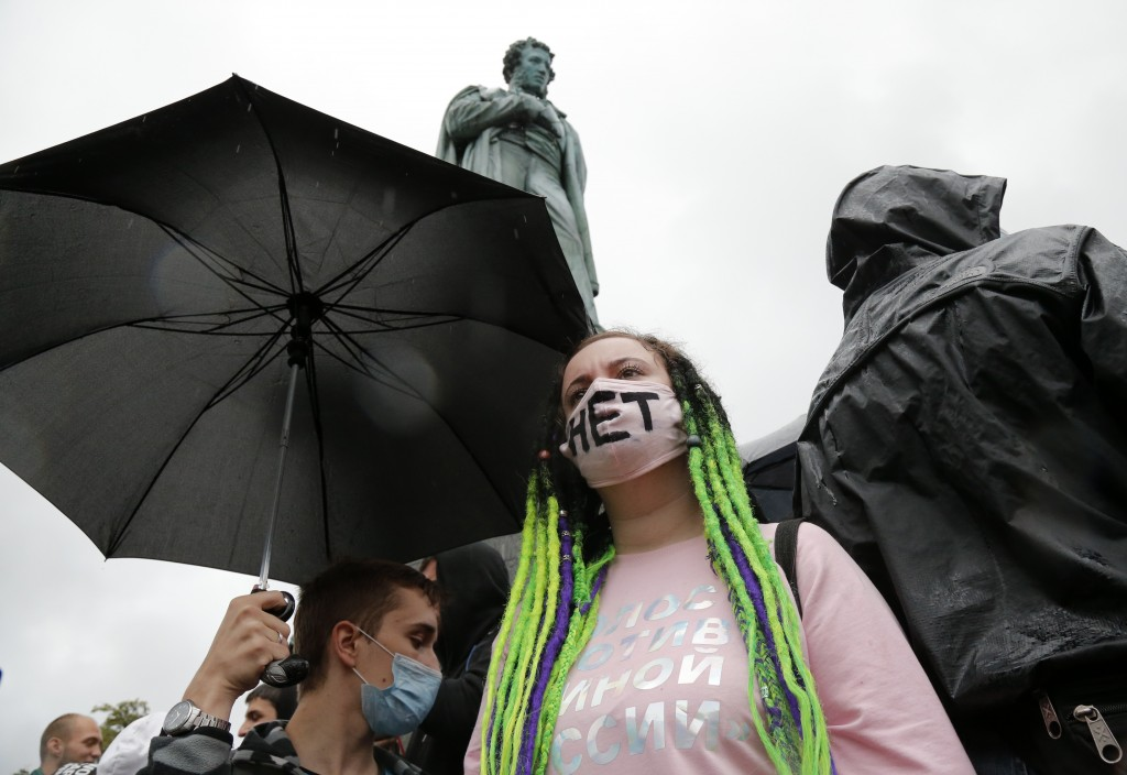 People gather to collection of signatures to cancel the results of voting on amendments to the Constitution in Moscow, Russia, Wednesday, July 15, 202...