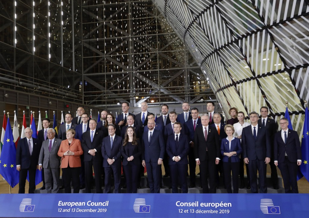 FILE - In this Thursday, Dec. 12, 2019 file photo, European Union leaders pose for a group photo during an EU summit in Brussels. European Union leade...