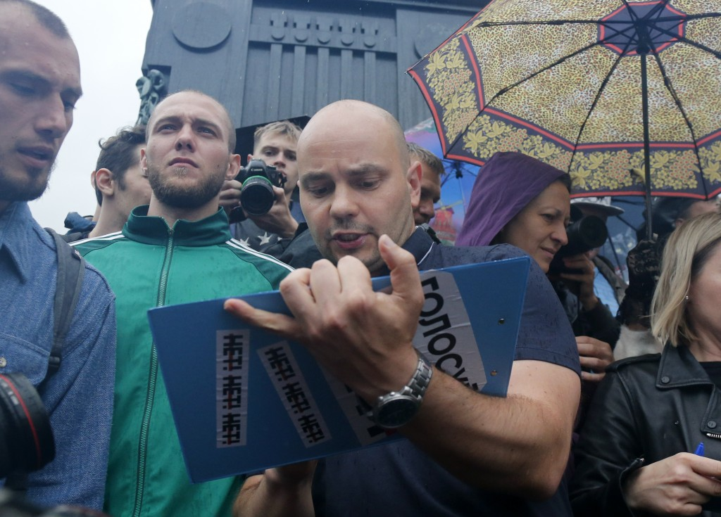 People gather to collect signatures to cancel the results of voting on amendments to the Constitution, in Pushkin Square, with a Pushkin monument in t...