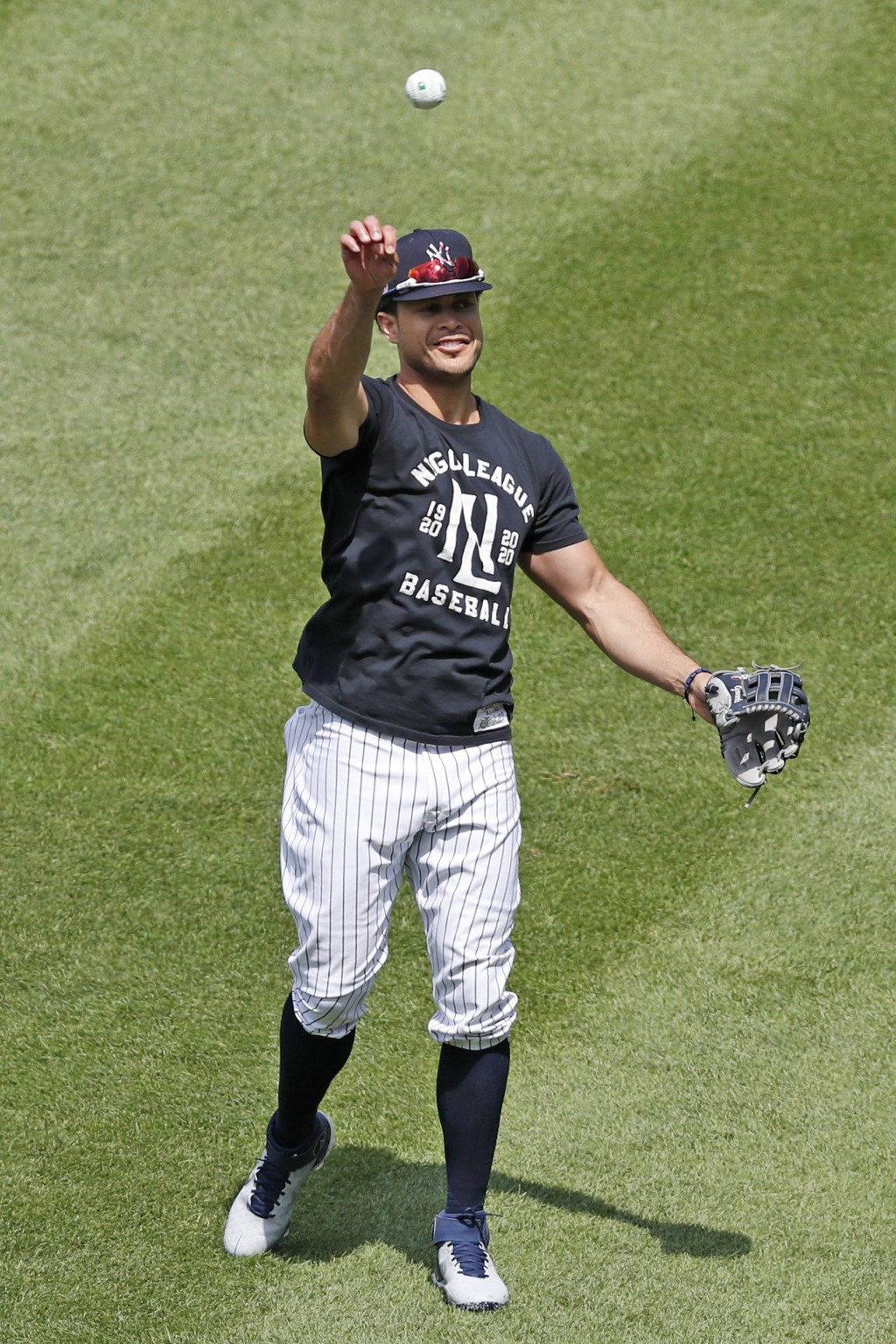 New York Yankees Giancarlo Stanton throws in the outfield during a workout at the Yankees summer baseball training camp, Wednesday, July 15, 2020, at ...