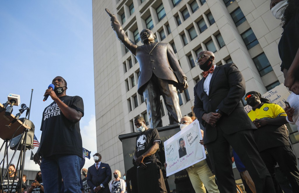Mondaire Jones, left, winner of the Democratic primary for the 17th Congressional District, addresses a Black Lives Matter rally near a statue of Mart...