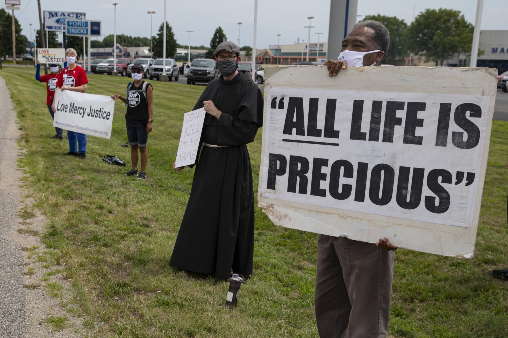 Protesters against the death penalty gather in Terre Haute, Ind., Wednesday, July 15, 2020. Wesley Ira Purkey, convicted of a gruesome 1998 kidnapping...