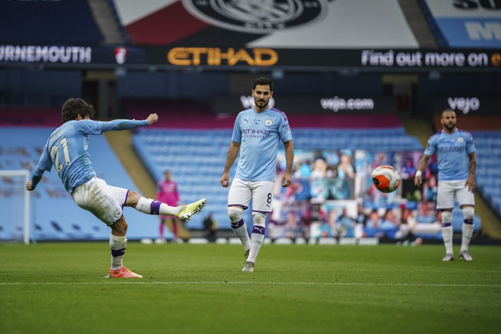 Manchester City's David Silva scores during the English Premier League soccer match between Manchester City and Bournemouth at the Ethiad Stadium in M...