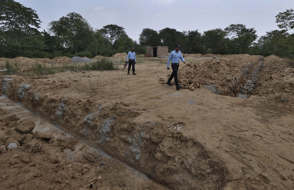 Police officers guard the site of a proposed Hindu temple after authorities stopped the construction, in Islamabad, Pakistan, Tuesday, July 7, 2020. A...