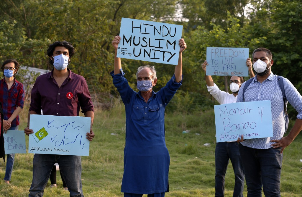 Members of a civil society group hold a demonstration demanding the government allow the construction of a Hindu temple, in Islamabad, Pakistan, Wedne...