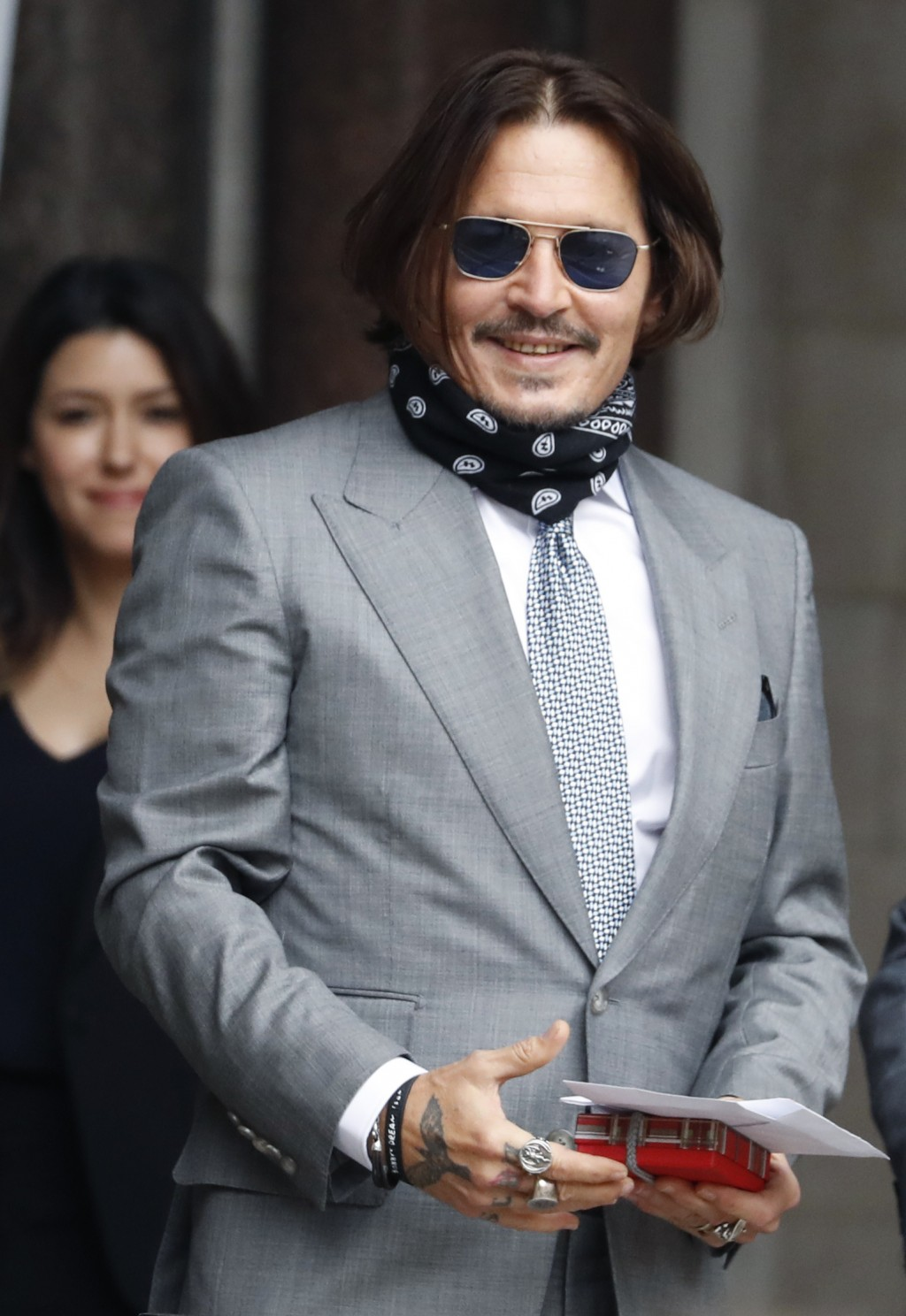 Actor Johnny Depp arrives at the High Court in London, Thursday, July 16, 2020. Depp is suing News Group Newspapers, publisher of The Sun, and the pap...