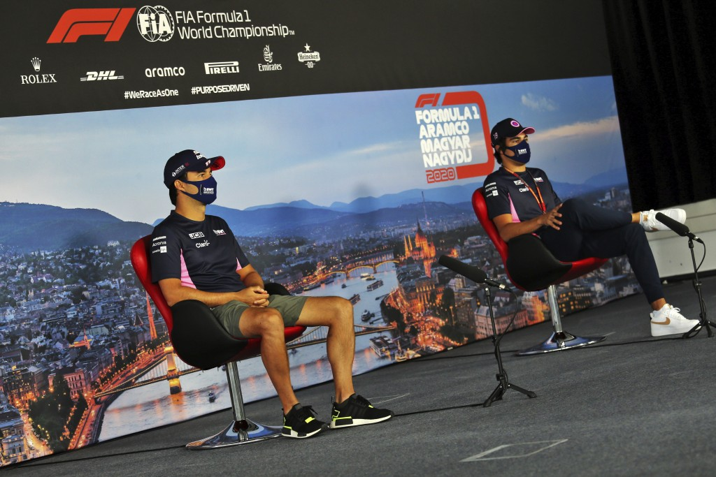 Racing Point drivers Lance Stroll of Canada, right and Racing Point driver Sergio Perez of Mexico attend drivers news conference at the Hungaroring ra...