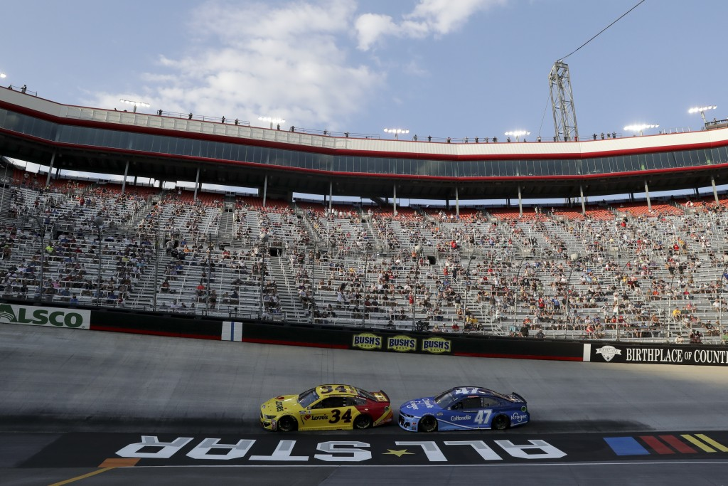 Michael McDowell (34) and Ricky Stenhouse Jr. (47) run during a NASCAR All-Star Open auto race at Bristol Motor Speedway in Bristol, Tenn, Wednesday, ...