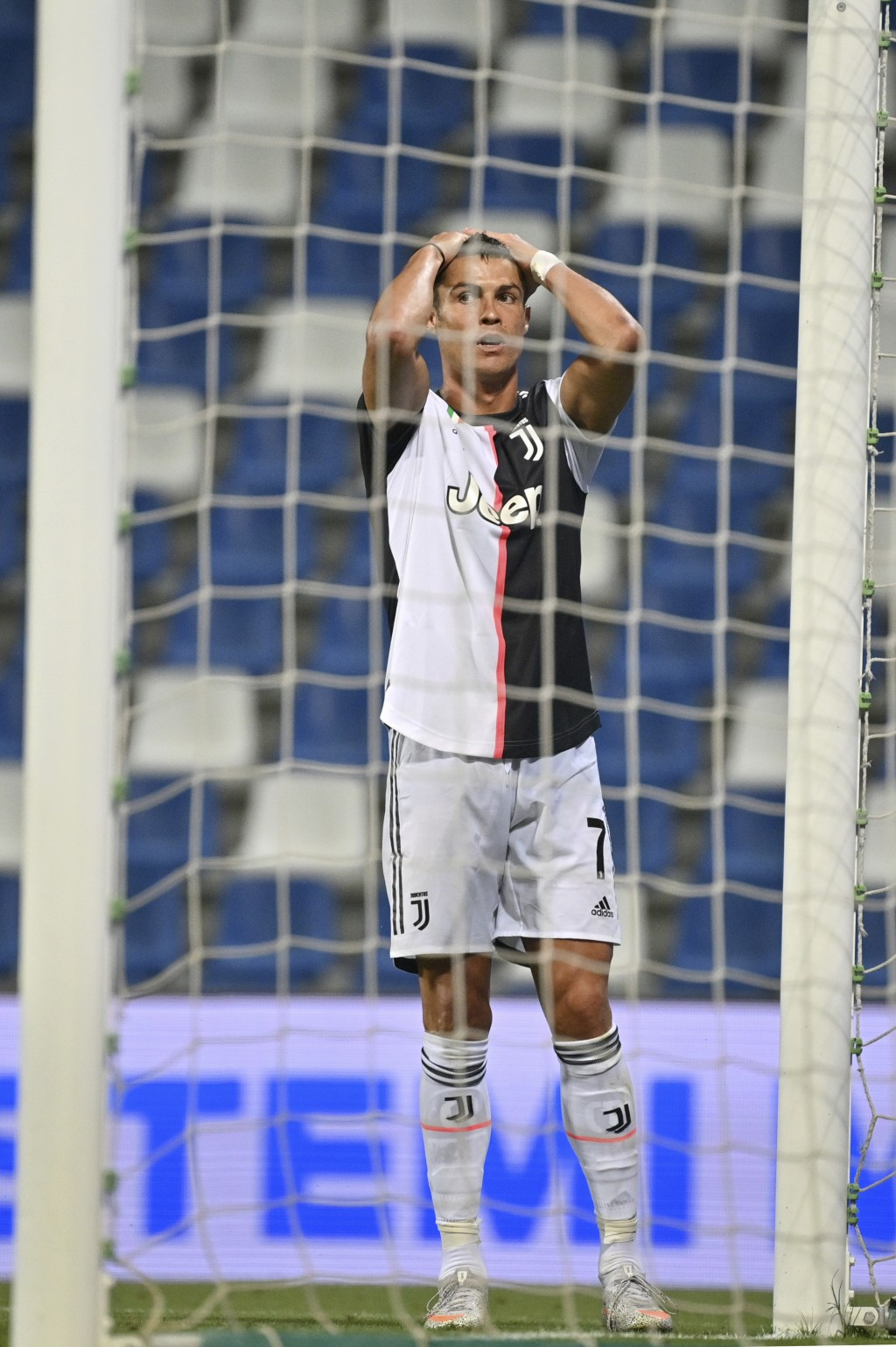 Juventus' Cristiano Ronaldo reacts during a Serie A soccer match between Sassuolo and Juventus at the Mapei Stadium in Reggio Emilia, Italy, Wednesday...