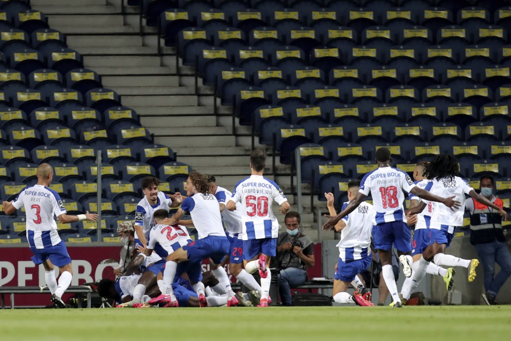 Porto players celebrate after scoring the opening goal during the Portuguese League soccer match between FC Porto and Sporting CP at the Dragao stadiu...
