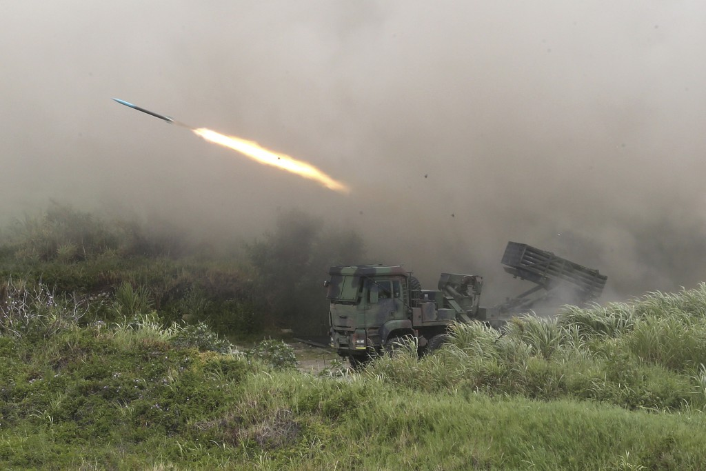A rocket is fired from a Thunderbolt 2000 multi-rocket launcher during the 36th Han Kung military exercises in Taichung City, central Taiwan, Thursday...