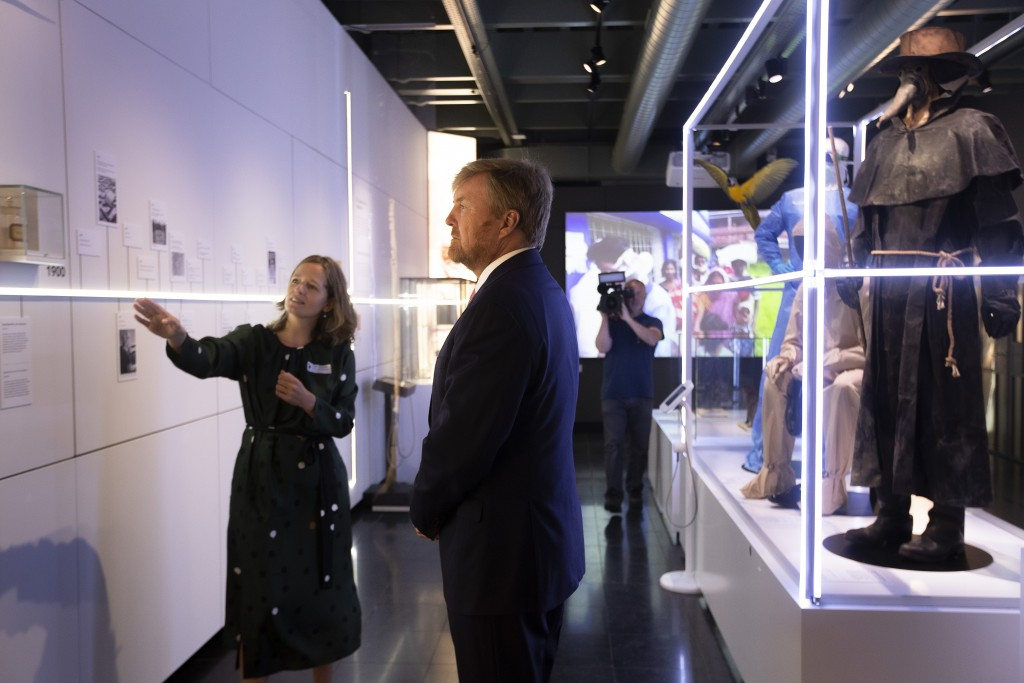 """Dutch King Willem-Alexander and curator Mieneke te Hennepe, left, tour the """"Contagious!"""" exhibit at Rijksmuseum Boerhave in Leiden, Netherlands, Thurs..."""