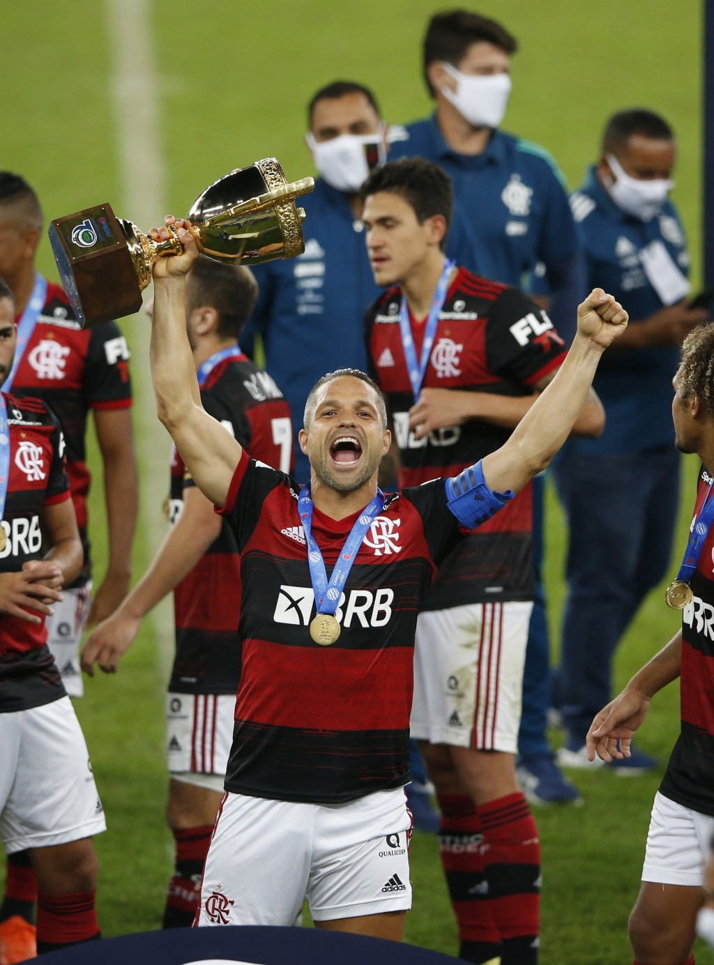 Soccer player Diego of Flamengo celebrates with the trophy after winning the Rio de Janeiro state championship at the Maracana stadium, Rio de Janeiro...